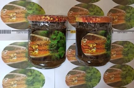deux pots de miel avec 12 plantes contre le fibrome et endométriose et ovaires polykstique